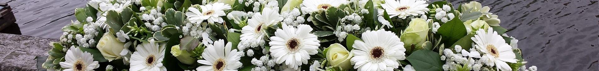 bloemen versturen naar  rouwarrangementen